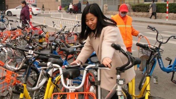 Li Xiang, 28 says she can halve her commuting time by using shared bikes.