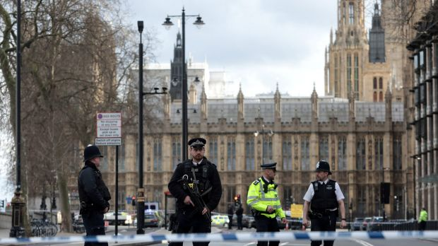 Armed officers at Westminster Bridge and the Houses of Parliament.
