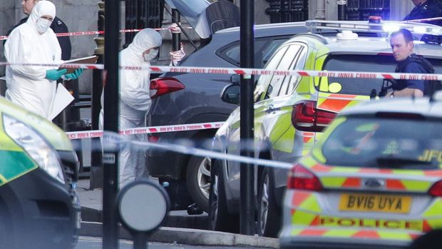 Police forensic officers at the scene close to the Houses of Parliament in London.