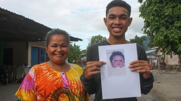 Pedro Unamet Remejio, right, was born in 1999 during the height of independence violence. Pictured here with his mum and ...