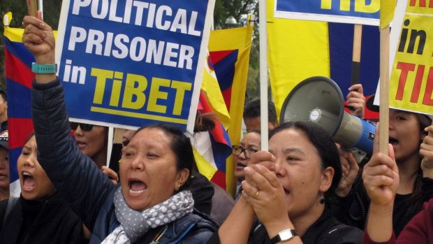 Free Tibet protesters demonstrate outside Australia's Parliament House in March.