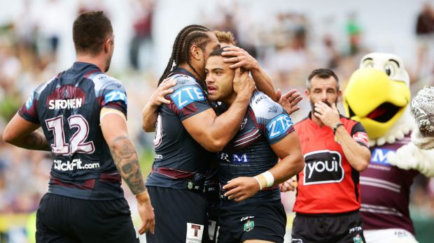 Try time: Dylan Walker celebrates scoring during Manly's big win.