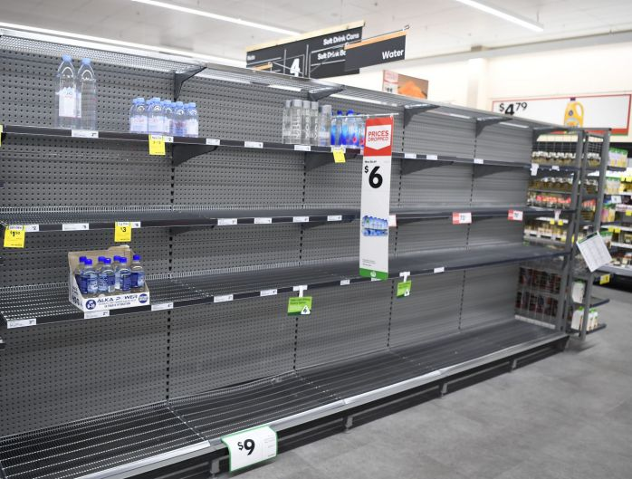 TOWNSVILLE, AUSTRALIA - MARCH 26: Empty supermarket shelves are seen as Townsville residents prepare for Cyclone Debbie ...