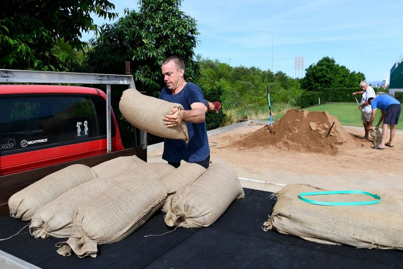 A Townsville resident puts sandbags in the back of his ute in preparation for Cyclone Debbie.