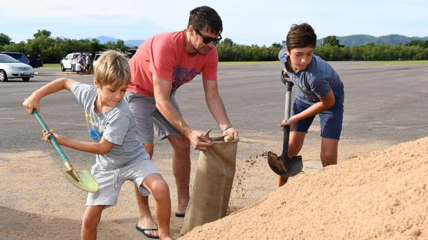 Townsville residents fill sandbags in preparation for Cyclone Debbie in March.