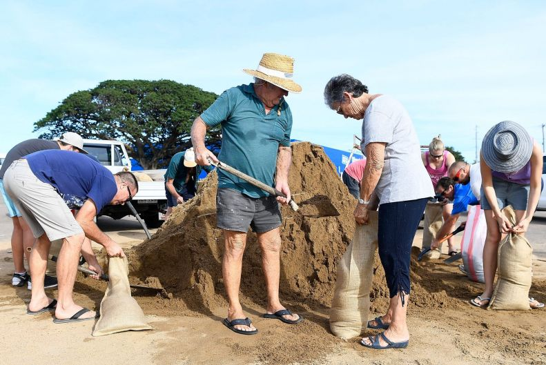 Townsville residents fill sandbags in preparation for Cyclone Debbie.