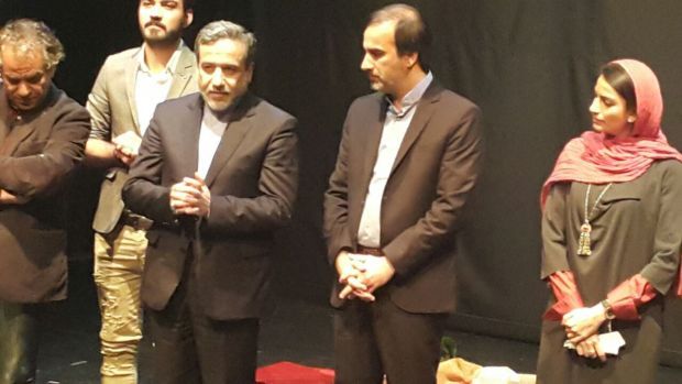 Iran's Deputy Foreign Minister Abbas Araghchi (third from left) with actors and producers.