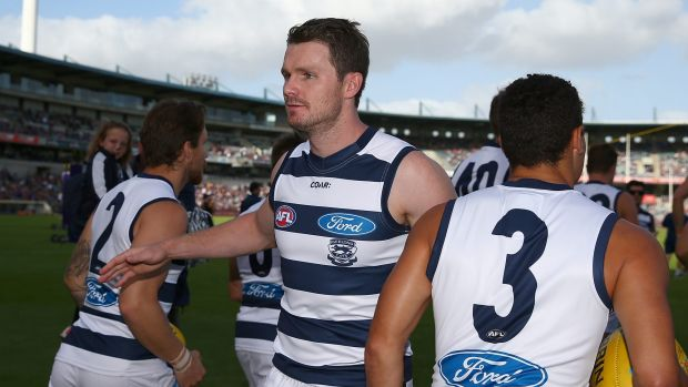 PERTH, AUSTRALIA - MARCH 26: Patrick Dangerfield of the Cats revs up his team mates while runningonto the field during ...