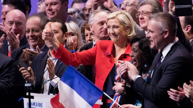 Marine Le Pen, France's presidential candidate and leader of the French National Front, gives a thumbs up during an ...