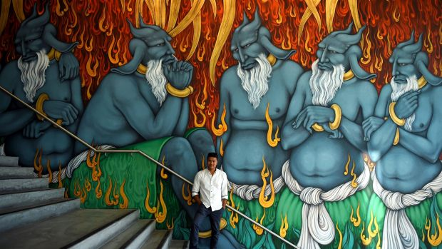 Artist Khadim Ali and his giant demons on show in the foyer of the Museum of Contemporary Art.