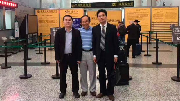 Professor Feng Chongyi at the Guangzhou Airport on Saturday with his lawyers Chen Jingxue, left, and Liu Hao , after ...