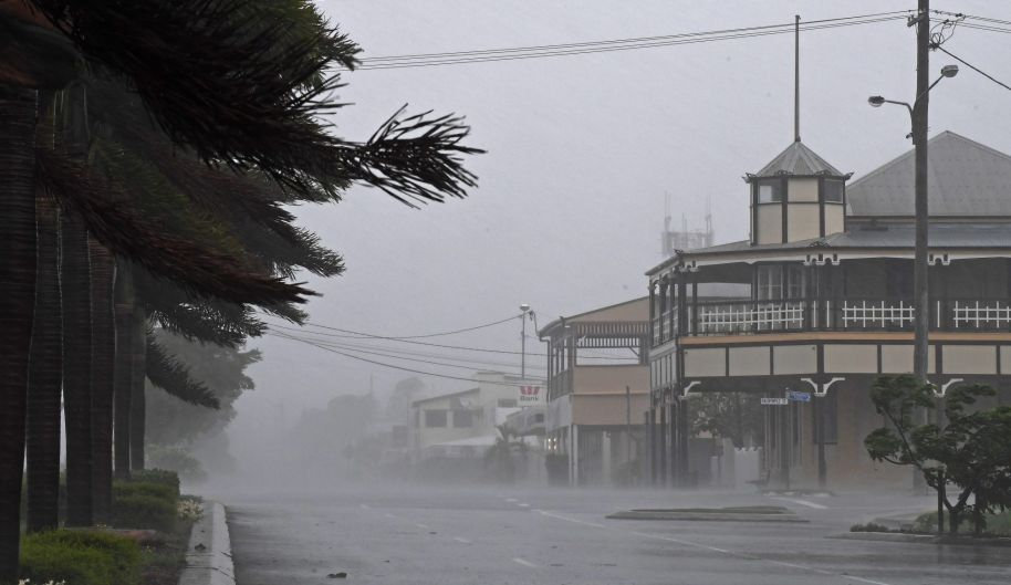 The town of Bowen is deserted and lashed by winds and rains before for the full force of the cyclone arrives at ...