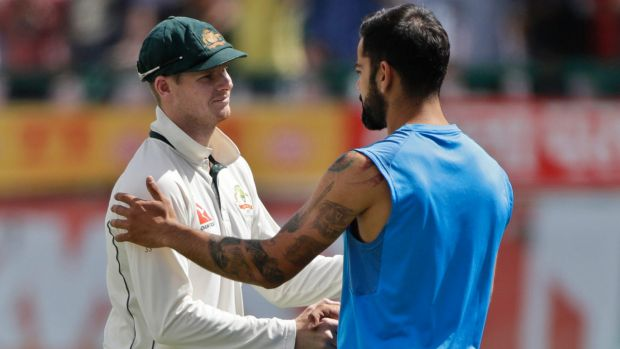 Conflict over: Steve Smith shakes hands with Virat Kohli after the fourth Test.