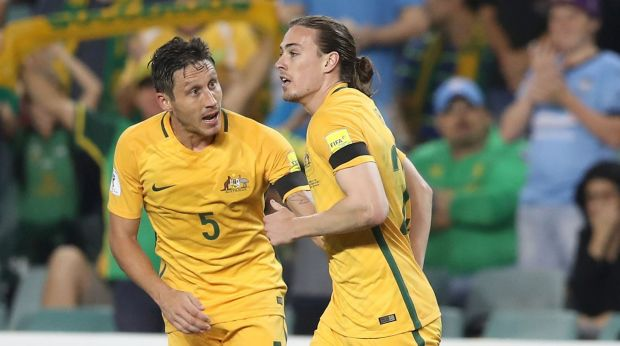 Mark Milligan (left) will likely captain the Socceroos at the Confederations Cup.