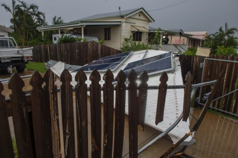 A lost roof lands in the neighbour's garden in Bowen.