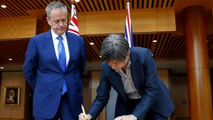 Opposition Leader Bill Shorten and Senator Penny Wong sign the condolence book for the London attack, at Parliament ...