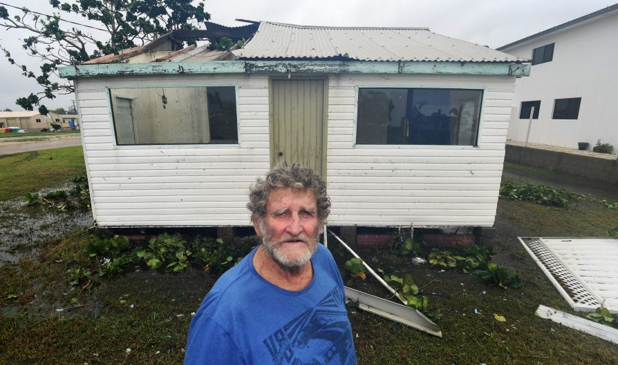 Bowen resident John Andersen in the remains of his cottage.