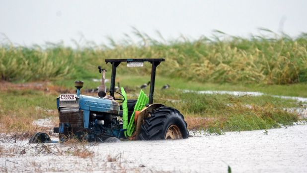 A tractor is seen inundated with water on a property south of Bowen, Queensland.