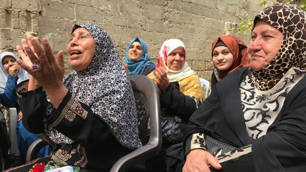 Older women sing at the Aged Care Association in Gaza, a country where many women face domestic abuse or economic ...