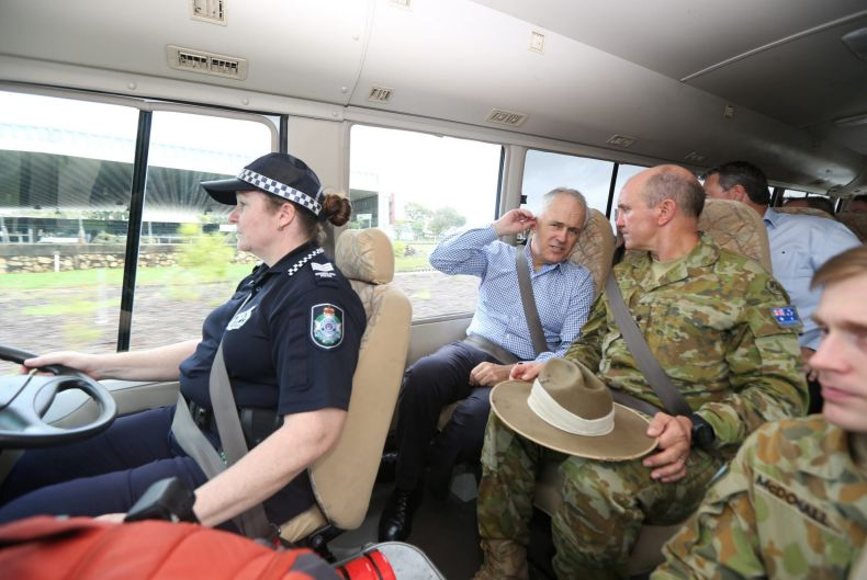 Australian PM Malcolm Turnbull and State Recovery Coordinator Brigadier Chris Field visit a cyclone damaged area March ...