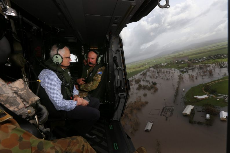 Australian PM Malcolm Turnbull and Opposition Leader Bill Shorten (not pictured) visit a cyclone damaged area March 30, ...