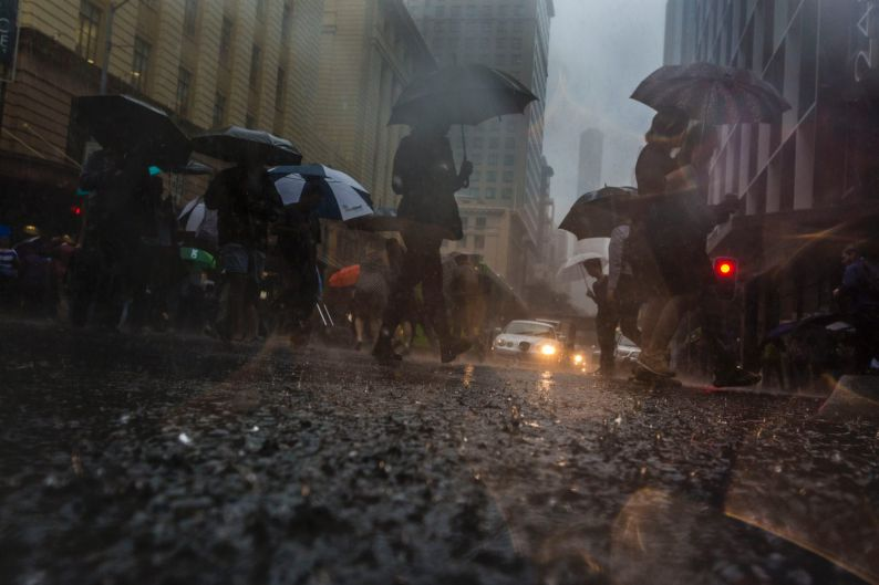 Thousands of Brisbane workers were sent home as the rain continued to fall.