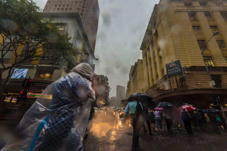 Brisbane commuters are hit by the rainfall brought by ex-cyclone Debbie.