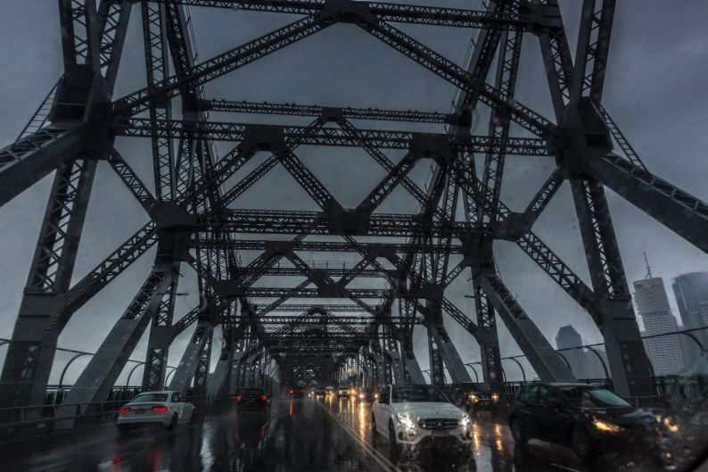 Motorists make their over the Story Bridge in a downpour caused by ex-Cyclone Debbie.