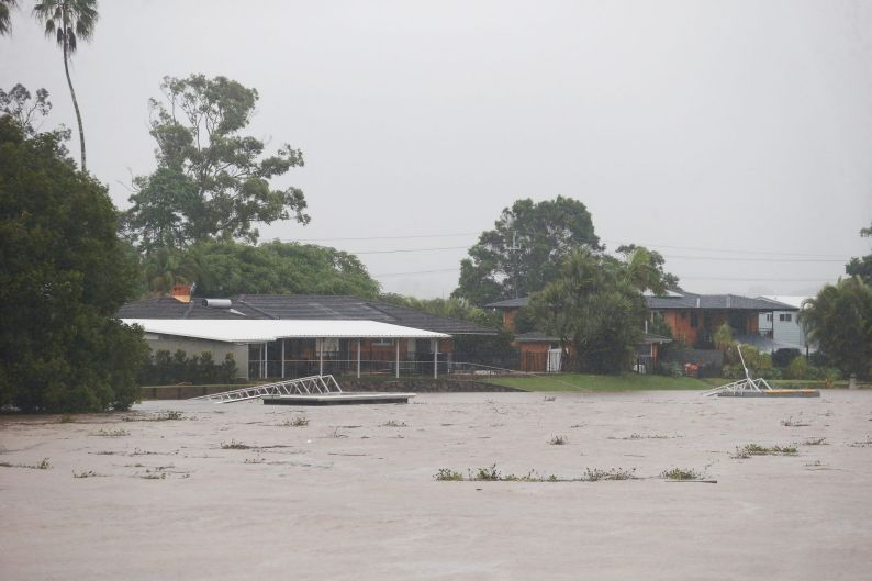Houses along the Tweed River as flood waters rise at Murwillumbah.