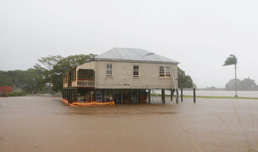 Houses threatened by flood waters at Murwillumbah.