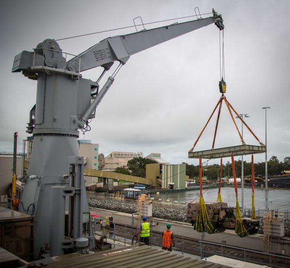 An Australian Army Mercedes Benz G-Wagon is loaded in to the vehicle deck of HMAS Choules.