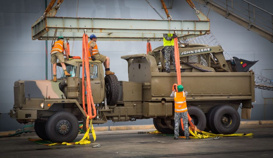A Mack R series dump truck is prepared to be loaded for the trip to North Queensland after Cyclone Debbie hit.