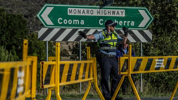 ACT Police conduct road traffic management near the scene of the fatal accident involving a cyclist and a car on the ...