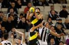 MELBOURNE, AUSTRALIA - MARCH 30: Ben Griffiths of the Tigers takes a spectacular mark over Henry Schade