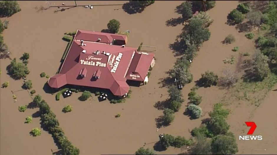 The landmark Yatala Pies store south of Brisbane is surrounded by floodwater.