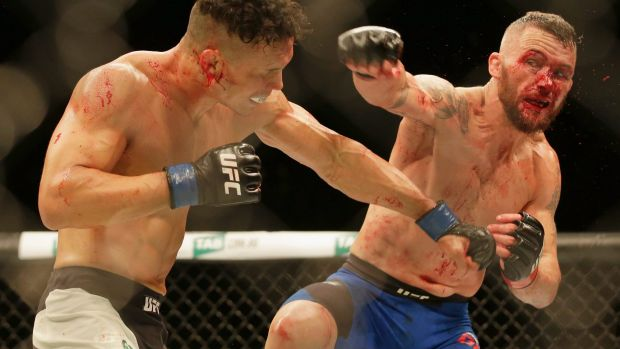 Jon Tuck, left, and Damien Brown fight during UFC Fight Night at Rod Laver Arena.