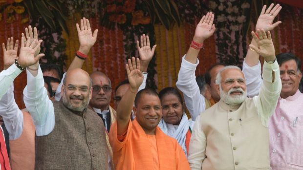Yogi Adityanath, centre in saffron robes, with Indian Prime Minister Narendra Modi, second from right, after ...