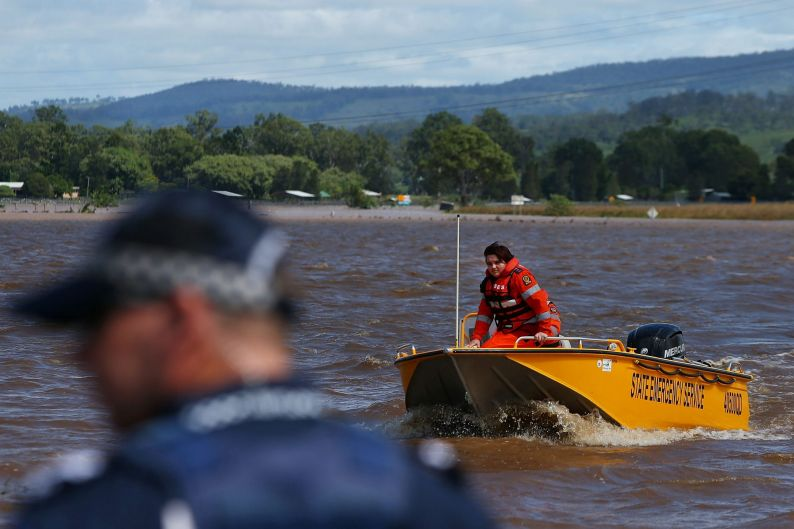 State Emergency Service workers help those affected by flooding in Beaudesert.