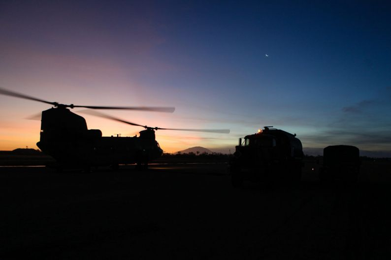 A CH-47 Chinook helicopter from 5th Aviation Regiment refuels at dusk after providing support to Proserpine residents ...