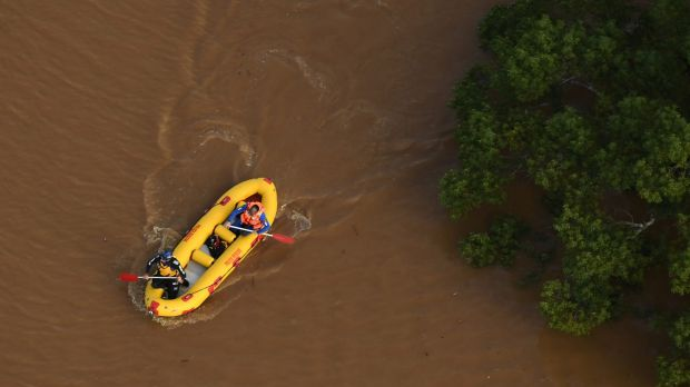 Lismore residents received text messages to move to higher ground, but swift-water rescue still operated in the area ...