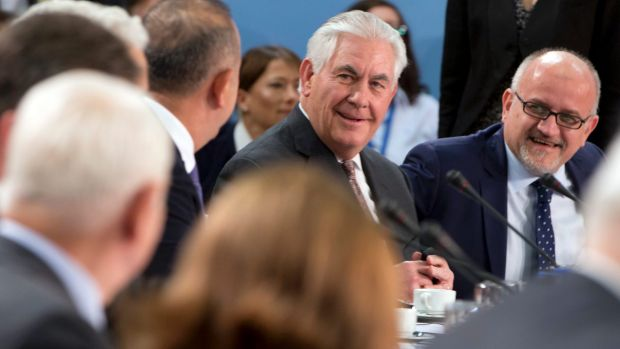 US Secretary of State Rex Tillerson speaks with Turkish Foreign Minister Mevlut Cavusoglu, centre, on Friday.