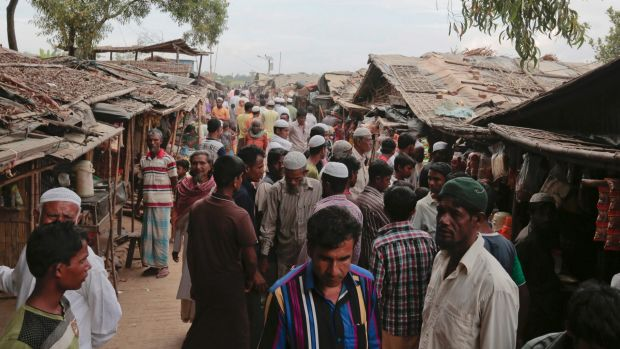 Rohingya Muslims from Myanmar mingle in an alley at an unregistered refugee camp in Teknaf, near Cox's Bazar, Bangladesh.