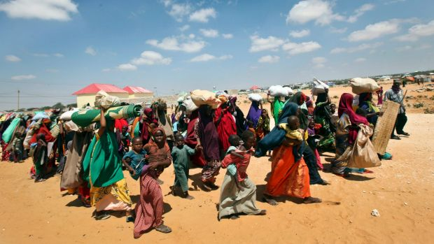Families internally displaced by drought arrive at makeshift camps in the Tabelaha area on the outskirts of Mogadishu, ...