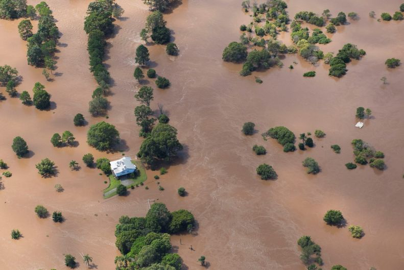 A lone house shown in an aerial photo taken on Friday in the Logan region where residents in low lying areas remained on ...