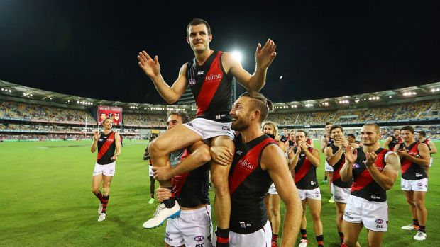 Brent Stanton is chaired from the field after a win in his 250th match.
