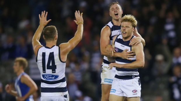 Left it late: George Horlin-Smith, Joel Selwood and Mitch Duncan celebrate the winning goal.