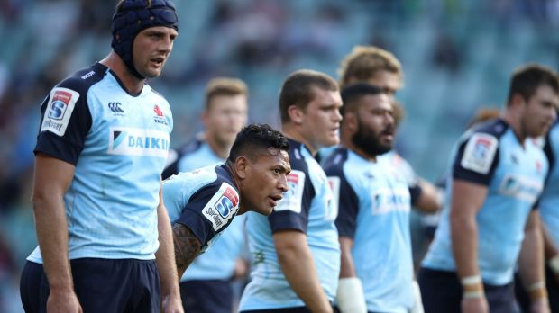Not again: The Waratahs look dejected after another Crusaders try.