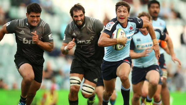 Bright spot: Jake Gordon makes a break for the Waratahs.
