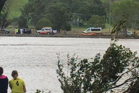 Emergency crews search the Tweed River near Tumbulgum for a missing car.