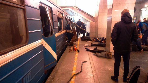 Blast victims lie near a subway train hit by a explosion at the Tekhnologichesky Institut subway station in ...